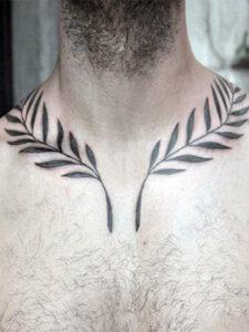 Тату лавровый венок на груди